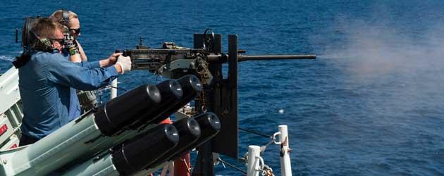 HMCS Regina firing .50 cal machine gun
