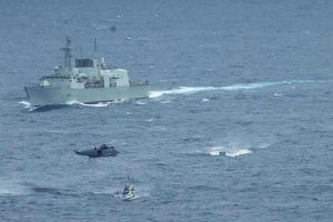 HMCS Ottawa's boarding party approaches a suspect vessel