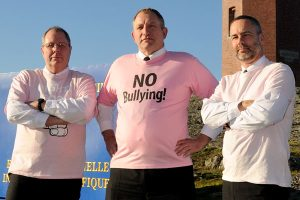 CPO1 Paul Helston, Capt(N) Mike Knippel and RAdm Bill Truelove stand against bullying