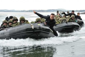 LS Paul Johnson helps bring a wave of Royal 22nd Regiment soldiers to land