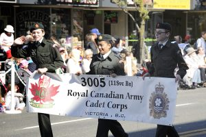 Members of the 3005 (11 Service Battallion) Royal Canadian Army Cadet Corps carry their unit banner past the dais at Centennial Square during the 116th Annual Victoria Day Parade.