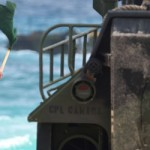 A Marine from Combat Assault Company, 3rd Marine Regiment signals the driver to proceed into the surf during RIMPAC on July 9, 2014.