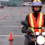 Shelley Fox sits on one of the Learn to Ride 250cc motorbikes at the Jetty parking lot where she was practicing the skills needed to pass the ICBC Motorcycle Skills test.